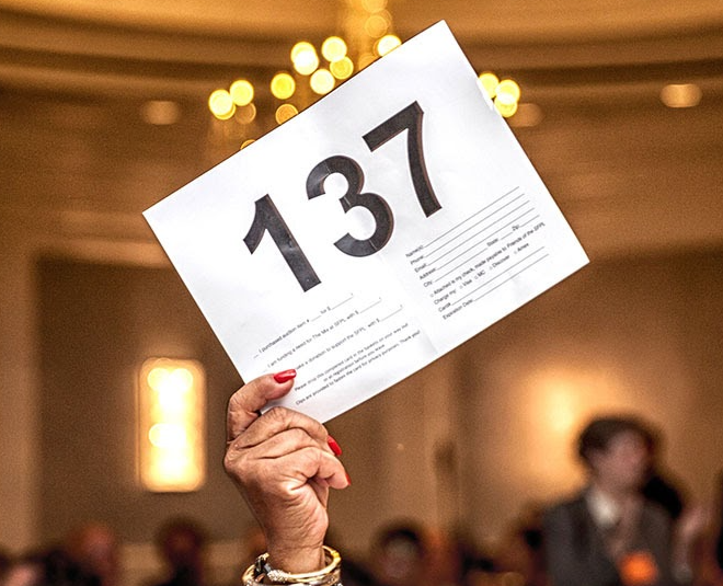 Person holding a number sign for an auction
